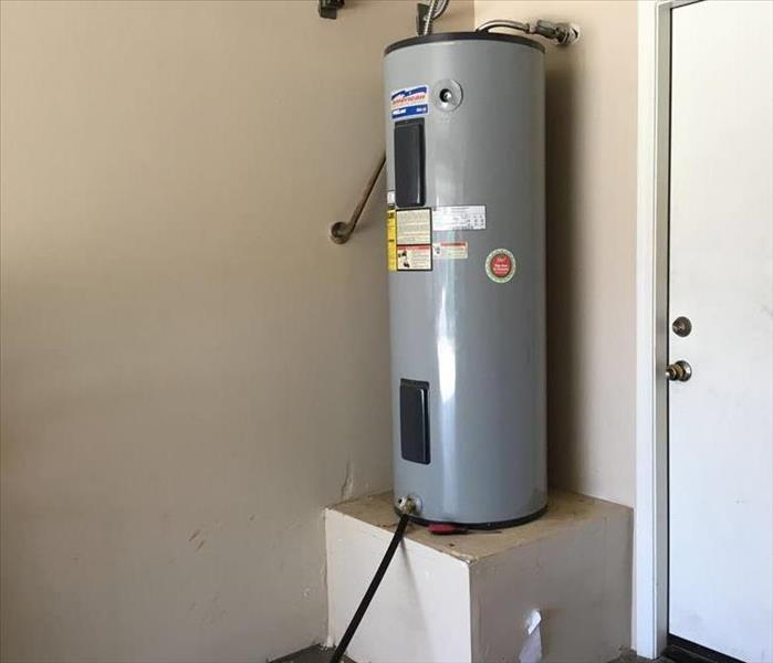 Faulty Water Heater In Garage