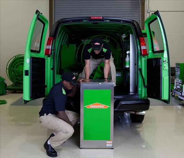 Technicians and a SERVPRO Truck